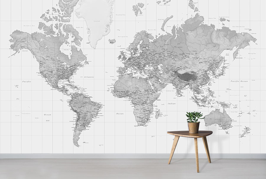 Black and White World Map Wallpaper Wall mural in situ with small table and plant