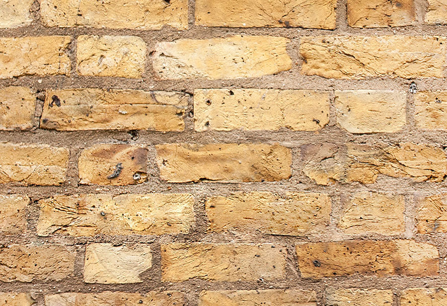 Close-up view of yellow brick effect wallpaper design