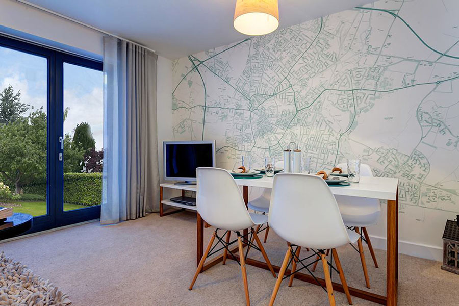 Personalised map wallpaper in the living room with chairs and televsion