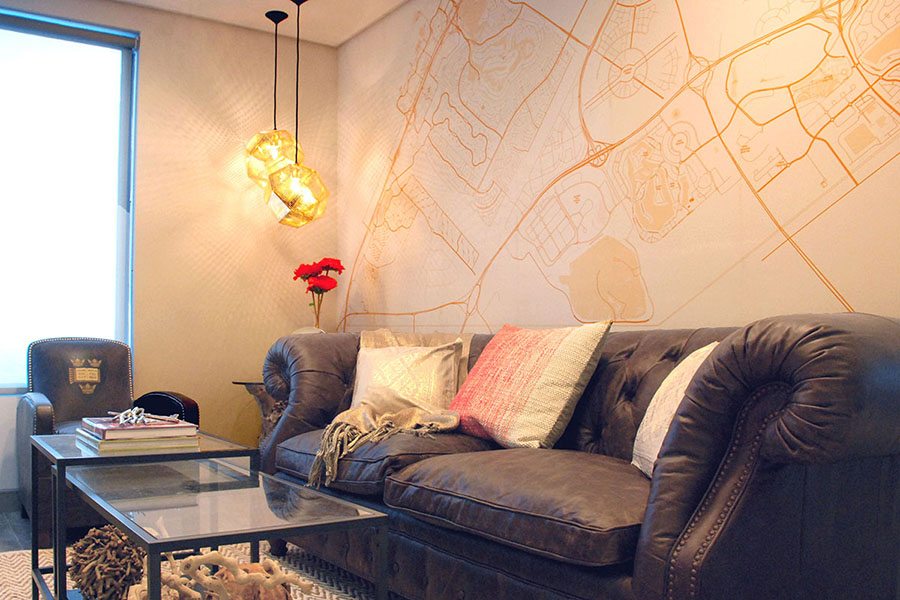 Custom Map Wallpaper in sitting room with sofas and coffee table