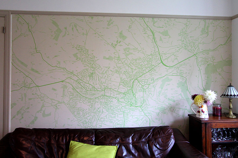 Custom Map Wallpaper in green in the home with sofa