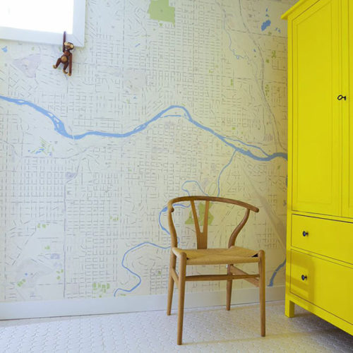 Custom Zipcode Map Wallpaper with bright yellow door and wardrobe and chair