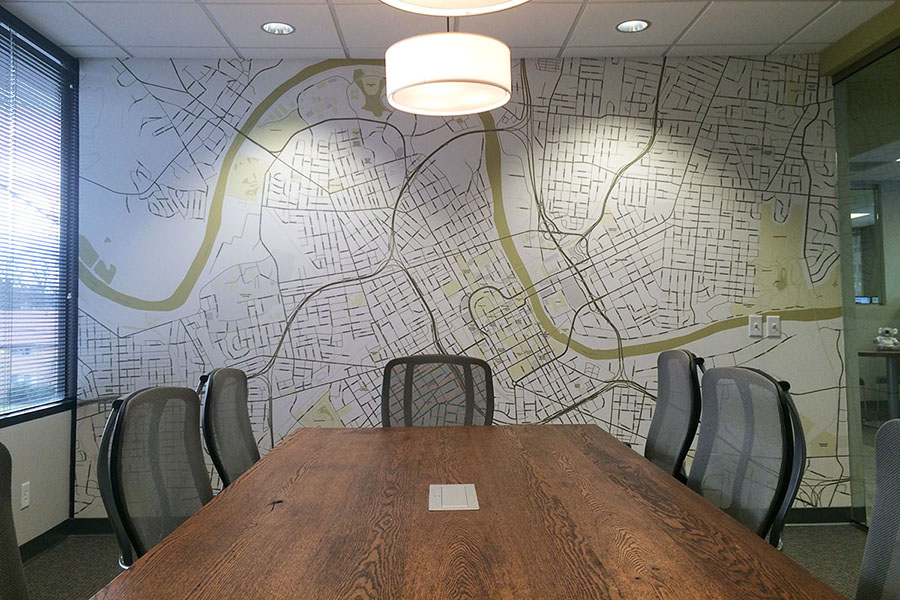Custom made zipcode map wallpaper in the boardroom with big table and chairs