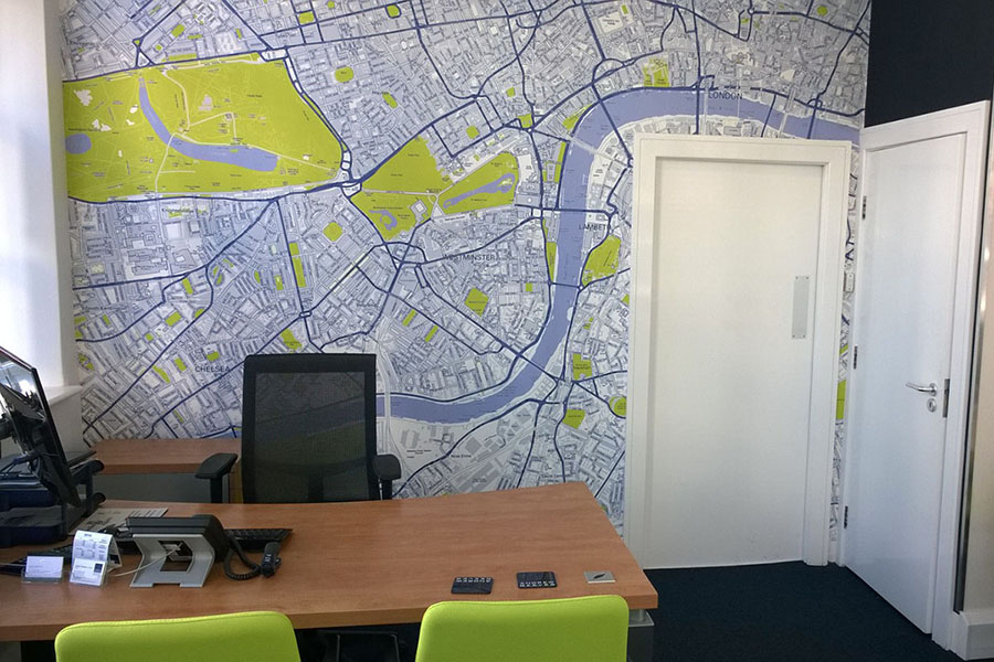 Colourful custom map wallpaper of London in an office with desk and chairs