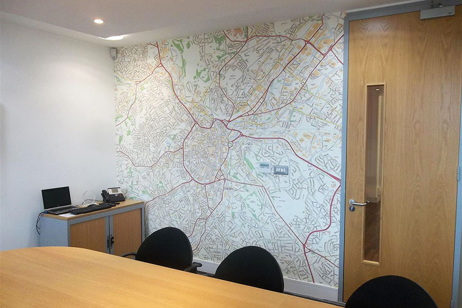 Bespoke area map wallpaper mural in office meeting room with big desk and chairs