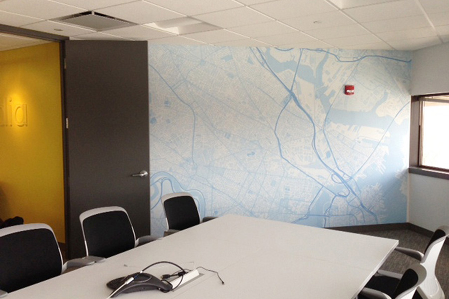 Bespoke zipcode map wall mural in meeting room with desk and chairs