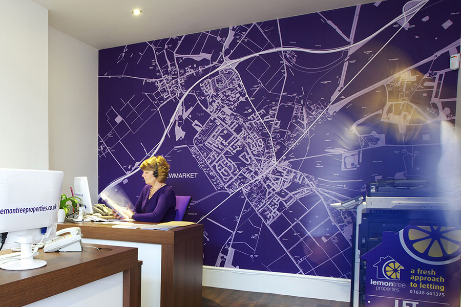 Purple custom map wallpaper in the office of an estate agent
