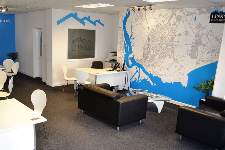 Estate agent office with bespoke map wallpaper and sofa