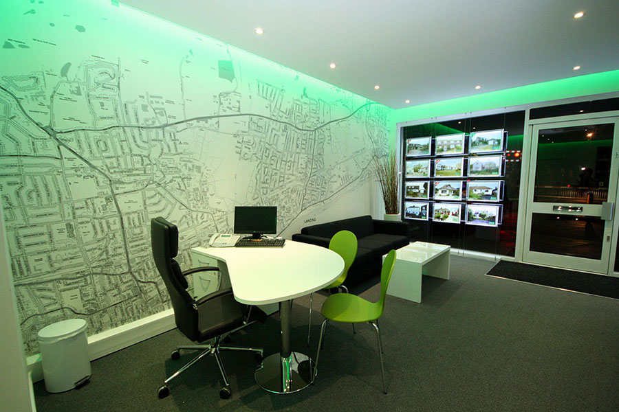 Local area map wallpaper mural in estate agent office with green lighting