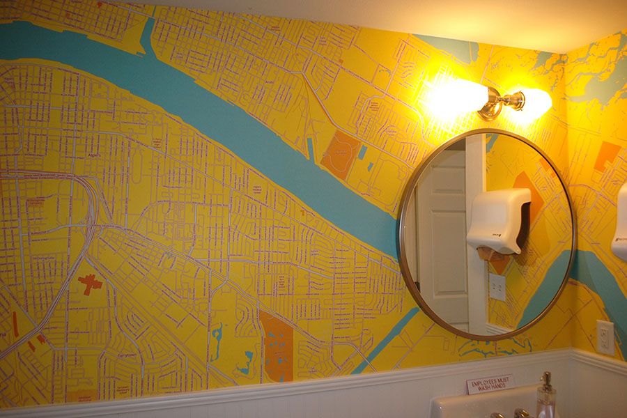 Bright yellow and blue custom made map wallpaper mural for restroom with mirror