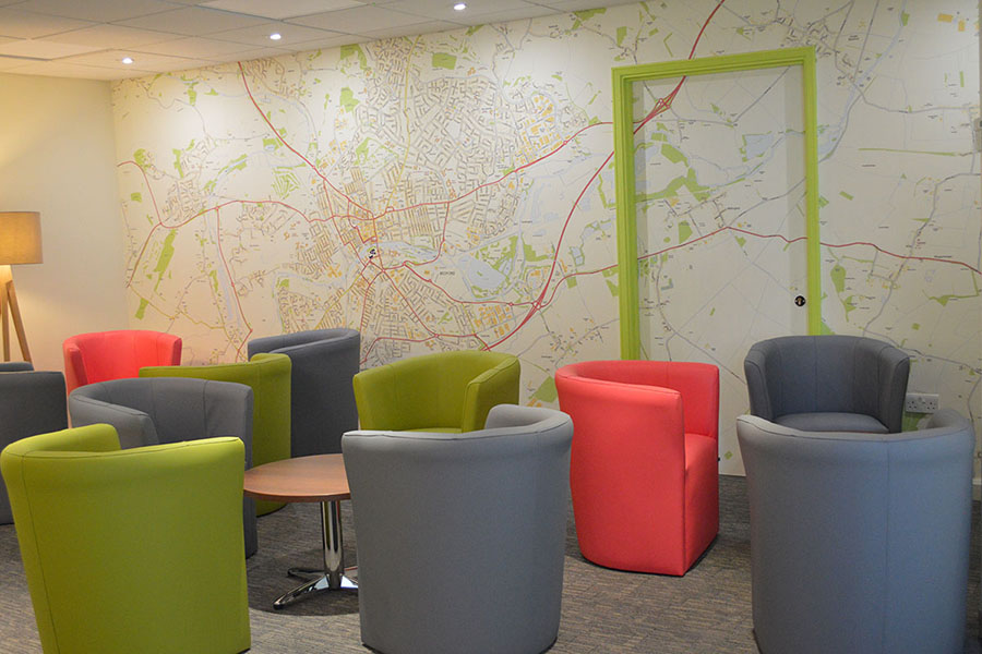 Local custom map wallpaper mural with colourful chairs